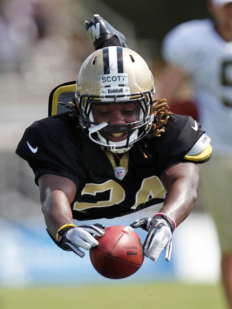 New Orleans Saints cornerback Laron Scott bats the ball during drills at NFL football training camp in Metairie, La., Wednesday, Aug. 1, 2012. (AP Photo/Gerald Herbert)