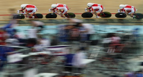 The Polish team, including Mateusz Nowak, Mateusz Nowaczek, Wojciech Pszczolarski and Mateusz Mikulicz compete in the Men's 3km Team Pursuit Qualifying race  during the European Track Cycling Championships in Panevezys, Lithuania, Friday, Oct. 19, 2012. (AP Photo/Mindaugas Kulbis)