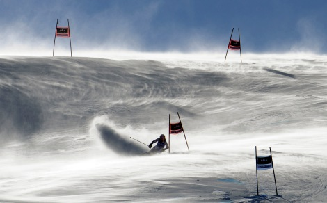Marion Bertrand, of France, fights gusting winds as she speeds down the course during an alpine ski, women's World Cup giant slalom, in Soldeu-Grandvalira, Andorra, Sunday, Feb. 12, 2012. (AP Photo/Giovanni Auletta)