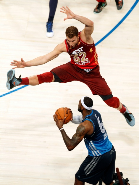 Western Conference's Blake Griffin (32), of the Los Angeles Clippers, jumps to block a pass by Eastern Conference's LeBron James (6), of the Miami Heat, during the NBA All-Star basketball game, Sunday, Feb. 26, 2012, in Orlando, Fla. The Western Conference won 152-149. (AP Photo/Lynne Sladky)