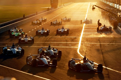 Cars pit during a caution flag in the IndyCar auto race at Auto Club Speedway in Fontana, Calif., Saturday, Sept. 15, 2012. (AP Photo/Reed Saxon)