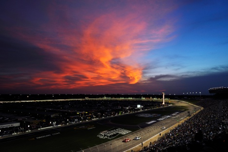 The sun sets behind clouds during the NASCAR Sprint Cup Series auto race at Atlanta Motor Speedway, Sunday, Sept. 2, 2012, in Hampton, Ga. (AP Photo/Rainier Ehrhardt)